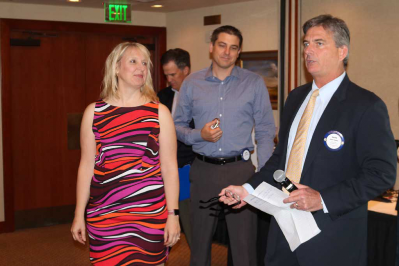 Past President David Dunlap (right) and sponsor Jason Griggs induct new member Dr. Sharyl Truty