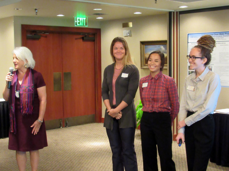 Rosemary Takacs introduces the five UNF students who are working on the Rotary-funded water project in Guatemala