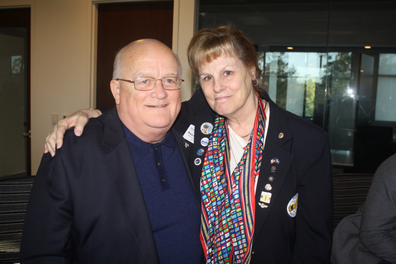 Paula Roderick (right) presented George Fetherston with a pin honoring his 18 years of dedicated service to RYE