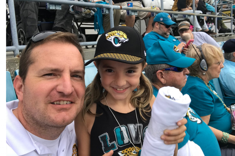 Rotary Club President Billy Wagner and daughter Skylar enjoy the Jags game
