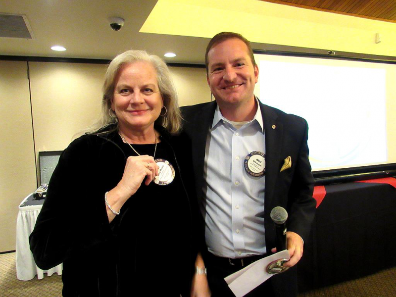 Mary  Merrill receives her Blue Badge from Club President Billy Wagner